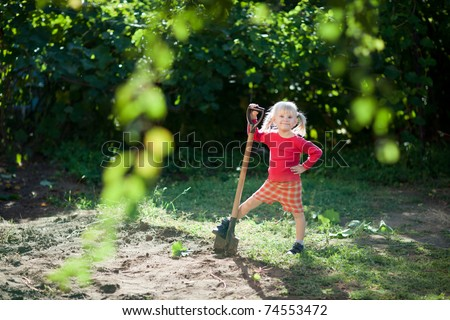 small girl helps to dig - stock photo