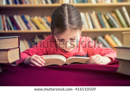 Small Girl in Old Library Reading Books - stock photo
