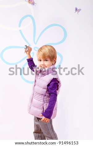 Small girl in pink vest with toy airplane isolated on purple background