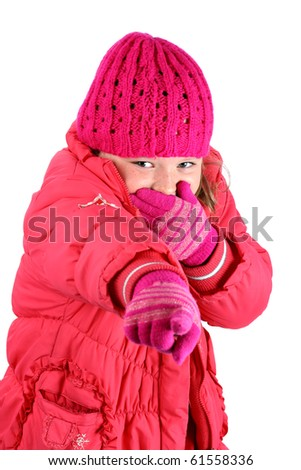 Small girl in red winter clothes laughing pointing her finger at camera isolated on white