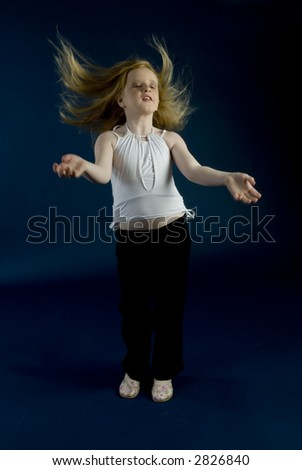 Small girl is jumping - stock photo
