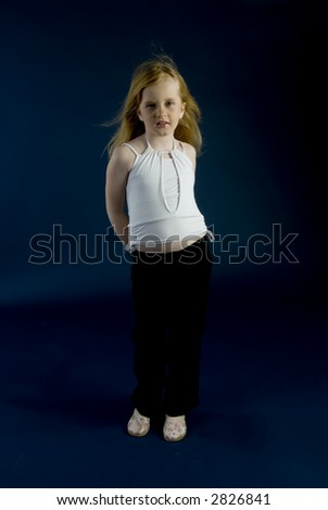 Small girl is standing - stock photo