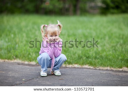 small girl outdoors in spring - stock photo