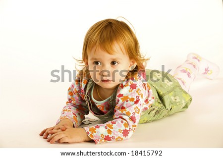 Small girl plays against the white background