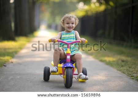 Small girl ride on a bicycle - stock photo
