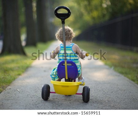 Small girl ride on a bicycle