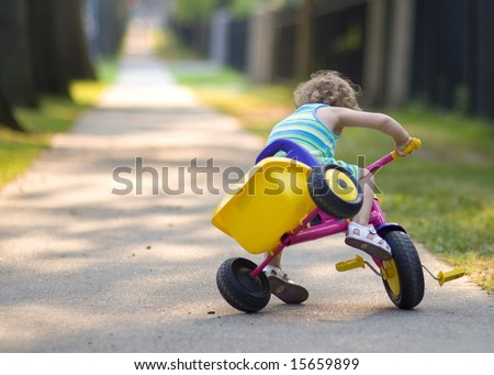 Small girl ride on a bicycle  - crash - car accident - stock photo