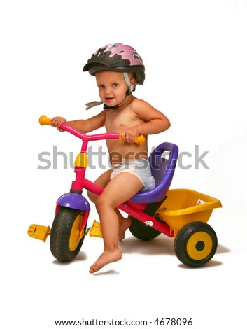 small girl riding bicycle - stock photo