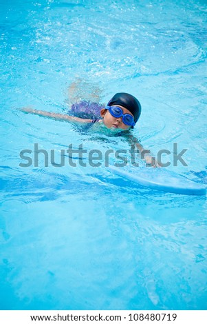 small girl swimming in the pool