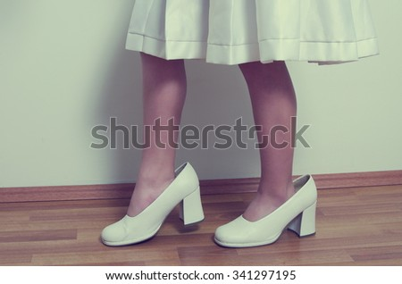 small girl with big adult shoes - stock photo