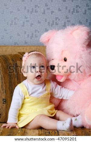 small girl with big toy bear - stock photo