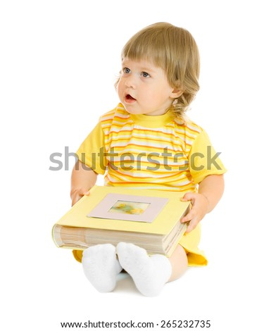 Small girl with family album isolated - stock photo