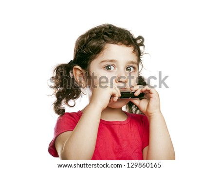 small girl with harmonica - stock photo