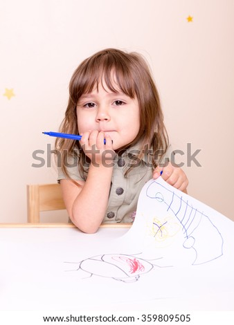 small girl with marker and her art - stock photo