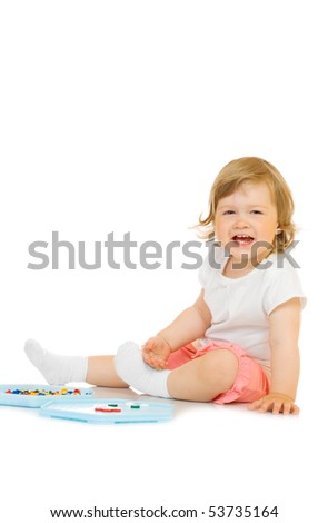 Small girl with toy mosaic isolated