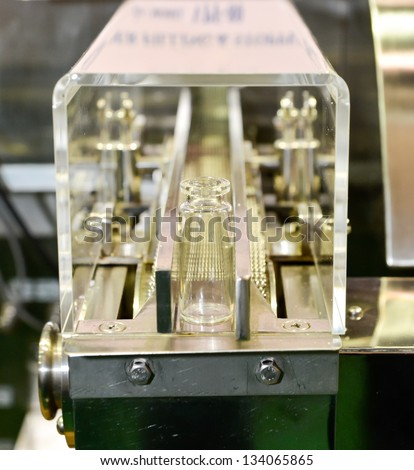 Small glass bottle on the conveyor - stock photo