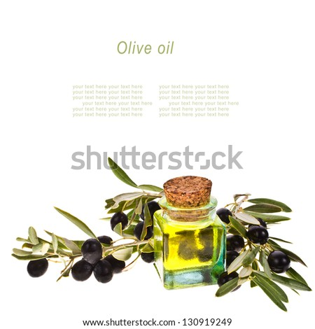 small glass bottle with olive oil, decorated with a small twig with black olives, fruit, isolated on white background with sample text - stock photo