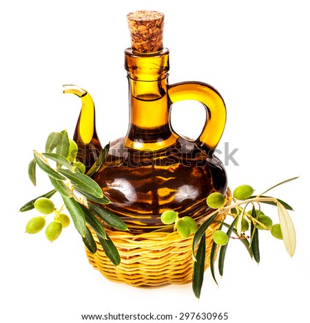 small glass bottle with olive oil, decorated with a small twig with green olives, fruit,  isolated on white background - stock photo