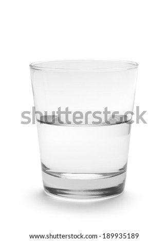 Small Glass of Water Half Full Isolated on White Background.