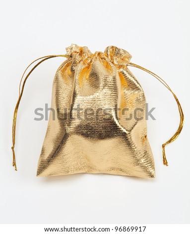 Small golden bag on white. - stock photo