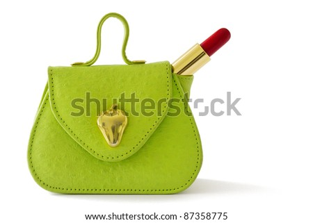 Small green bag and red lipstick, isolated on white background - stock photo