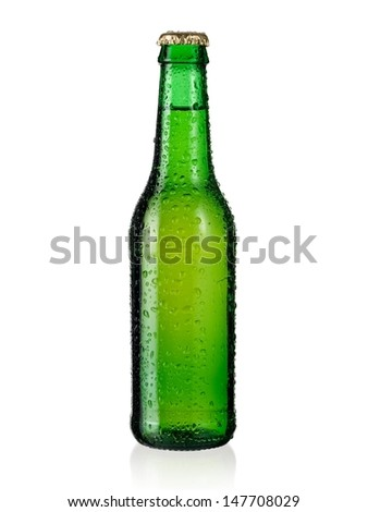 Small green beer bottle with drops - stock photo