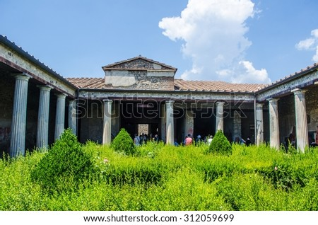 small green courtyard inside of the ruins of pompeii city complex near italian naples. - stock photo