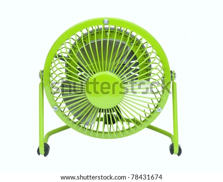 small green fan to help keep you cool in the hot summer time on a white background - stock photo