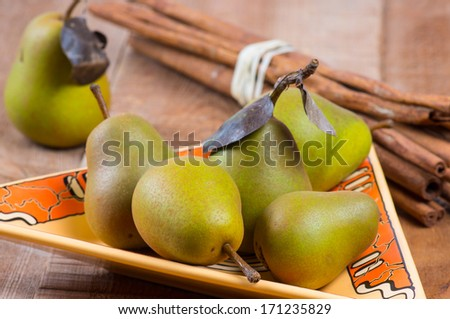 Small green pears in a plate - stock photo