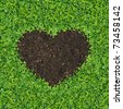 Small green plants, soil, fertilizer is a heart shape. - stock photo