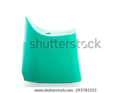 Small green plastic stool for kids isolated on white background - stock photo