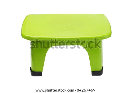 Small green plastic stool on isolated white background - stock photo