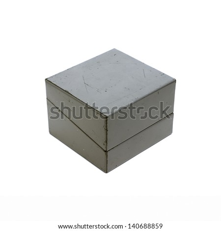 Small grey metal stationery box with hinged lid (closed) isolated on a white background. - stock photo