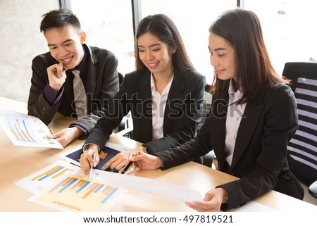 Small group of  Asian people are focus on documents at a business meeting