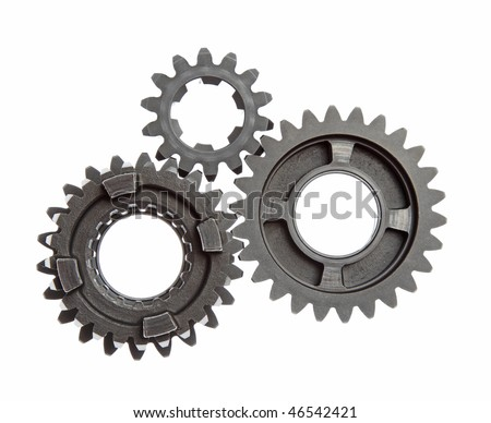 Small group of gears with their teeth engaged on a white background. - stock photo