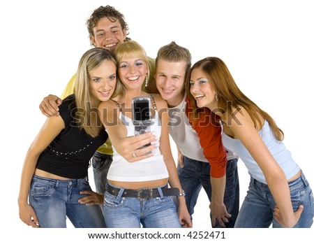 Small group of happy teenagers. Smiling and taking photograph. White background, front view - stock photo