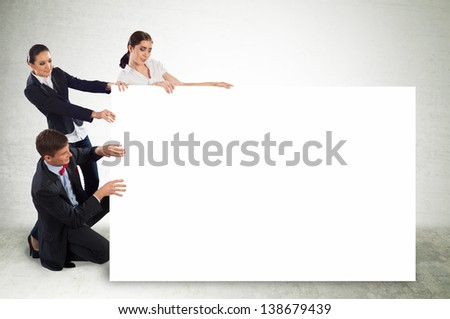 small group of people holding a blank banner, place for text - stock photo