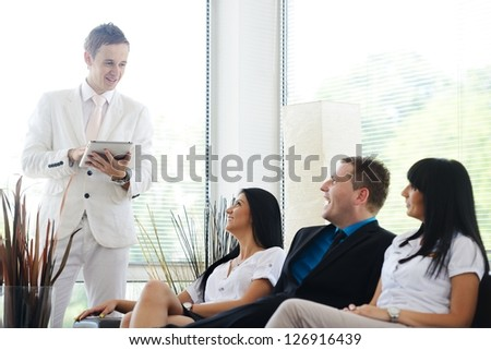 Small group of people seal a deal with their personal financial adviser at home - stock photo