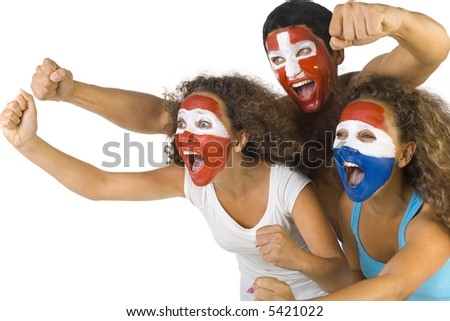Small group of screaming, international sport's fans with painted flags on faces and with clenched fists. Side view, white background - stock photo