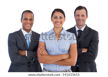 Small group of smiling business people standing together on white background - stock photo