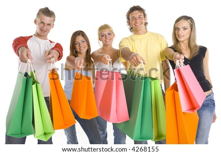 Small group of smiling teenagers. Holding and giving shopping bags. Looking at camera. White background, front view - stock photo