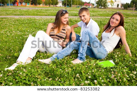 small group of students in a clearing on meadow - stock photo