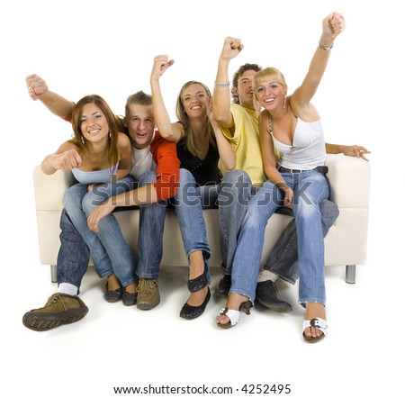 Small group of teenagers sitting on couch and cheering. Looking at camera. White background, front view