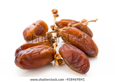 small group of tropical dates, isolated on white