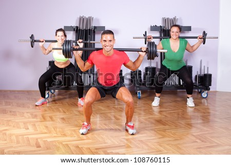 Small group of young people in aerobics class - stock photo