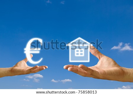 Small hand exchange Euro icon with house icon from big hand, Concept - stock photo