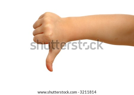 Small hand is showing thumb down. - stock photo