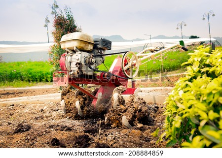 Small hand tractor in the garden - stock photo