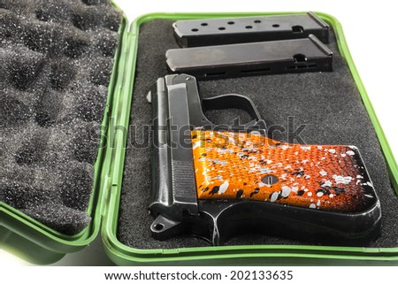 Small handgun 6.35 mm. on white background. - stock photo