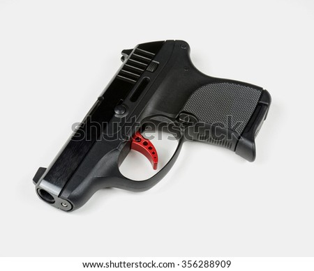 Small Handgun with Red Trigger - stock photo